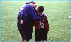 Father and son at school football match