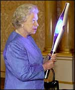 The Queen holds the futuristic Commonwealth Games baton