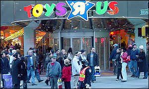 Shopper in front of Toys R Us