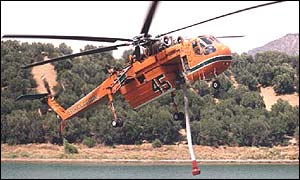 A helitanker fights fires outside Sydney