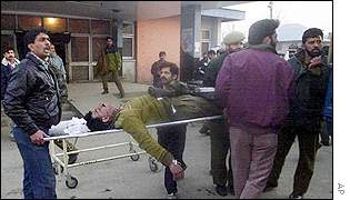 Indian policeman being taken to hospital after grenade attack in Kashmir