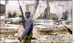 Nigerian soldier after rioting in the state of Kaduna, February, 2000