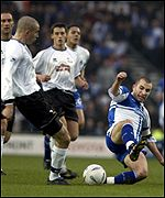 Lewis Hogg of Bristol gets past Danny Higginbotham of Derby