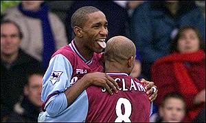 West Ham striker Jermain Defoe celebrates the first of his two goals with Trevor Sinclair