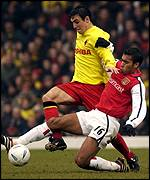 Gary Fisken tackled by Giovanni Van Bronckhorst