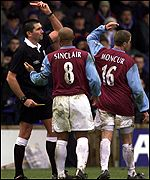 Referee Jeff Winter sends off West Ham's John Moncur