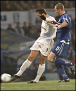 Mark Viduka makes the most of Cardiff defender Spencer Prior's mistake to score