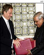 Tony Blair and Atal Behari Vajpayee exchange documents after signing anti-terrorism declaration