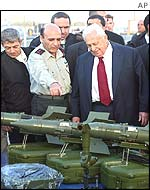 Ariel Sharon with weapons seized on board the ship