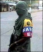 FARC guerrilla on street patrol