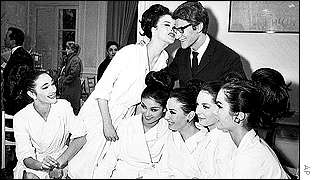 Mr Saint Laurent with models wearing clothes from his Spring 1964 collection