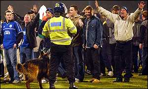 Riot police hold back the crowd at Ninian Park