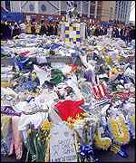 Leeds fans lay floral tributes to the fans killed in Istanbul