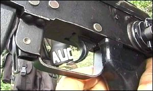 An AUC gun with the acronym of the group