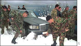 Lebanese soldiers work to reopen the main road in the southern mountain town of Jezzine