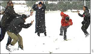 Syrians play in the snow on the Qasseyoun Mountains surrounding Damascus