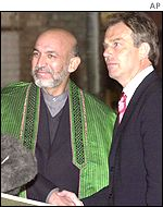 Tony Blair with Hamid Karzai at Bagram airport