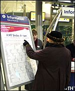 A rail passenger checks the strike damage