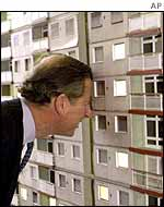 Prince Charles peering into model of high-rise flats