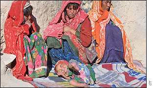 Three women in Bonavash watching over a sick child