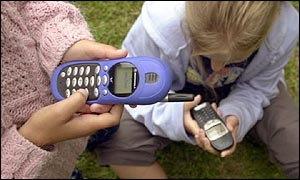 Girls using mobile phones