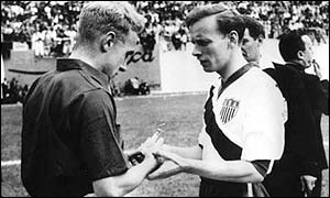 Billy Wright swaps souvenirs with Ed McIlvenny before kick-off at the 1950 World Cup