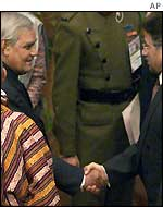 Atal Behari Vajpayee (left) shakes hands with Pervez Musharraf