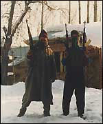 Masked militants brandishing weapons