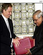Indian PM Atal Behari Vajpayee presents Blair with the Delhi declaration against terrorism