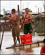[ image: Residents resort to rafts in Malabon near Manila]