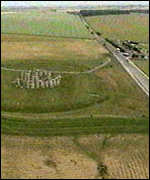 [ image: Stonehenge stands less than 100yds from a major road]