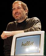 [ image: Apple's Steve Jobs with the iMac]