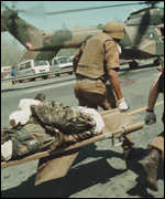 [ image: South African medics evacuate a soldier]