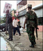 [ image: Soldiers patrolled the streets of the capital in search of looters]