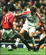 [ image: Mac attack: McAteer tries to beat Giggs]