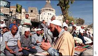 Muslims praying outside the Basilica of the Annunciation