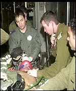Israeli soldiers tend wounded colleague