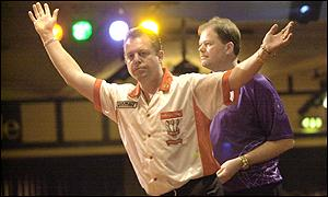 Mervyn King of England celebrates a 180 on his way to victory