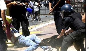 Police tackle rioter during December protests which brought down President Fernando de la Rua