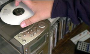 CD being placed in a stereo system (BBC)