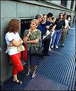 People queue outside a Buenos Aires bank