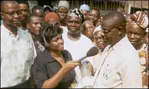 The community gather in the Ajegunle ghetto, BBC