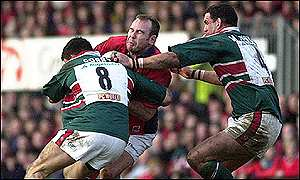 Scott Quinnell is halted by Martin Corry and Martin Johnson