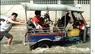 Tuk-tuk stuck in a flood