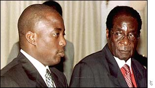 Joseph Kabila (left) and Robert Mugabe (right) in Malawi