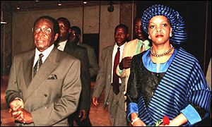 Robert Mugabe and his wife Grace arrive at an international conference in Harare on Saturday