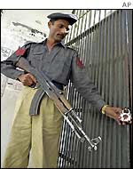 A policeman checks the lock at the office of Tehrik-e-Jafria in Karachi