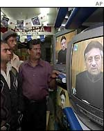 People in Karachi watch General Pervez's Musharraf's television speech