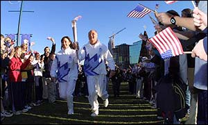 4 Dec 2001: Olympic athlete Peggy Fleming runs the second leg at the beginning of the 2002 Salt Lake Olympic Torch Relay in Centenial Park in Atlanta, Georgia