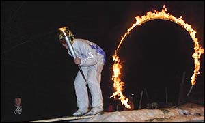 Ski jumper Chris Baker jumps through a ring of fire off a ski jump during the 2002 Salt Lake Olympic Torch Relay in Lebanon, New Hampshire